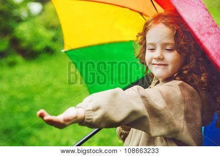Little Girl  Hiding Under An Umbrella From The Rain