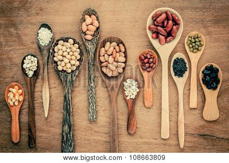 Assortment Of Beans And Lentils In Wooden Spoon On Teak Wood Background. Mung Bean, Groundnut, Soybe