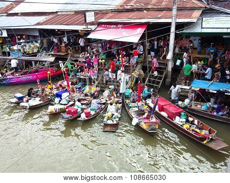 Samutsakorn, Thailand - July 25, 2015: Village And Market Along A River With Longtail Boat With Food