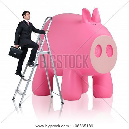Man rises up on the stepladder near piggy bank