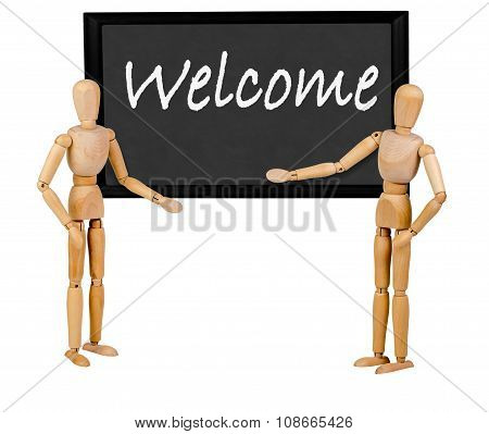 two mannequins pointing to blank blackboard stating 'welcome'