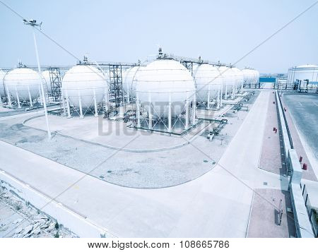 oil and fuel tanks in oil depot, empty road front