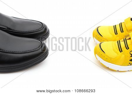 Yellow Shoes For Son And Black Ones For Dad On White As Filiation Concept
