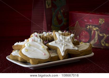 Decorated Christmas Cookies beside Gifts
