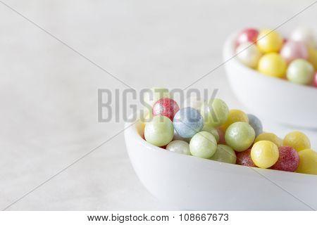 Sugar Pearls in Spoons - Horizontal Selective Focus