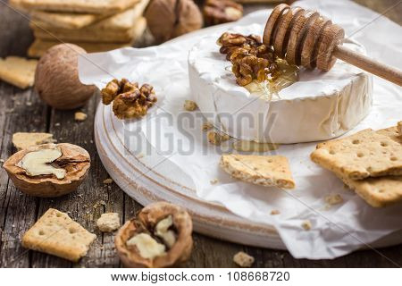 Camembert Cheese With Crackers, Nuts And Honey
