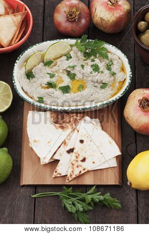 Baba ghanoush, levantine eggplant dish with olive oil and parsley