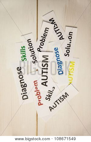Autism words on wooden table shot in studio