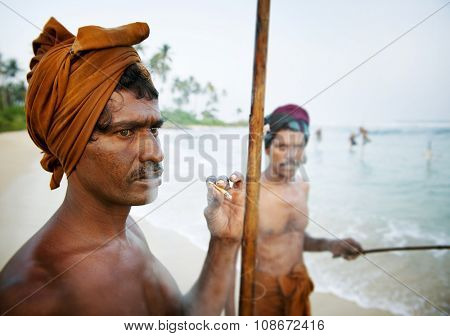 Fisherman Smoking Shore Sri Lankan Rod Fishery Concept