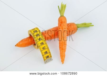 carrots from organic farming with tape measure. fresh fruits and vegetables is always healthy. symbolic photo for healthy diet.