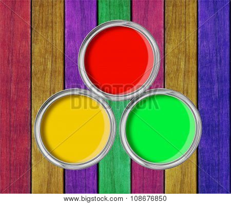 Open Tin Cans With Paint On Paint Wooden Background