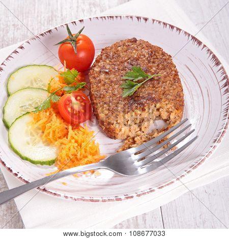 vegetarian patties, bulgur galette and salad