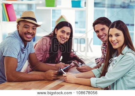 Young creative team using phones in casual office