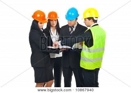 Group Of Architects Having Conversation