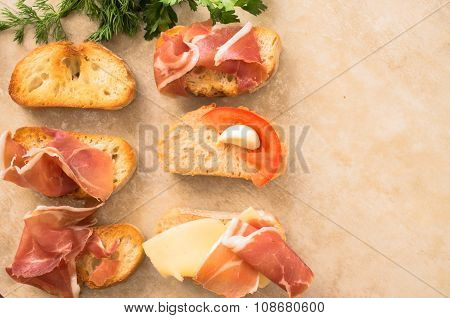 Variety Of Tapas With Meat, Cheese And Vegetables