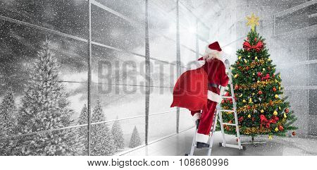 Santa steps up a ladder against home with christmas tree