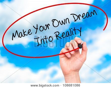 Man Hand writing Make Your Own Dream Into Reality with black marker on visual screen.