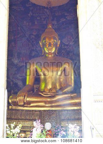 Buddha on the church and smoke from joss stick
