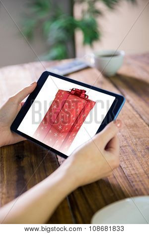 Woman using tablet pc against remove