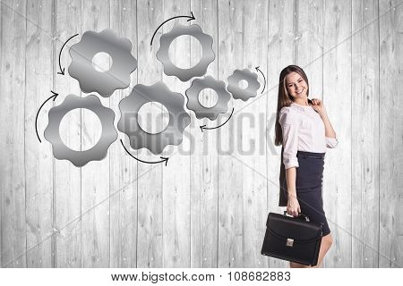 Business woman with metal gears