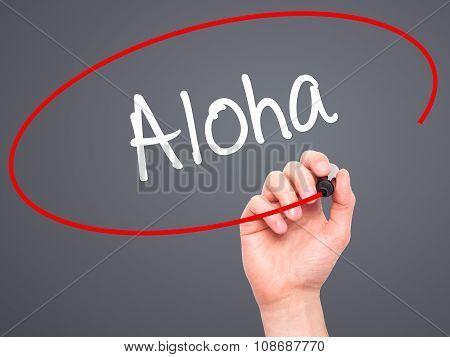 Man Hand writing Aloha with black marker on visual screen.