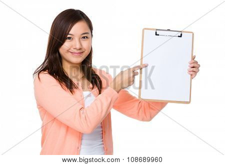 Woman with finger point to clipboard