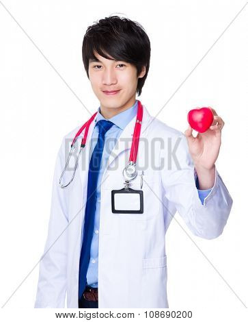Male doctor hold with heart ball