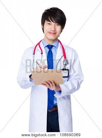 Doctor man write on clipboard