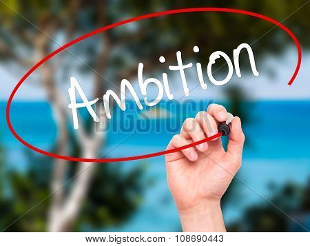 Man Hand writing Ambition with black marker on visual screen