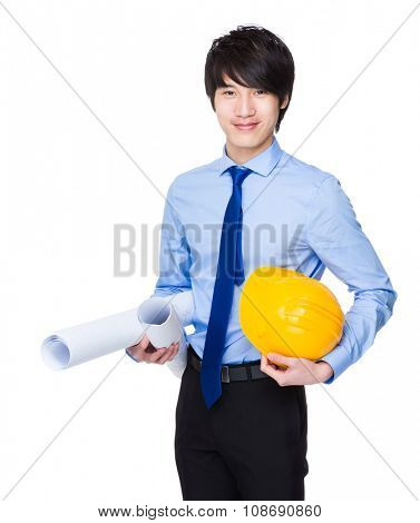 Construction engineer hold with blue print and safety helmet