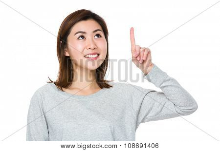 Asian Young Woman touch on the imaginary button