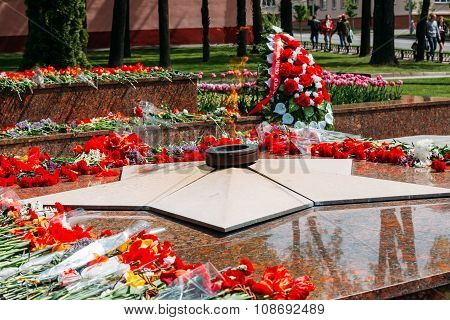 Wreaths and flowers lie on a communal grave of Soviet soldiers w