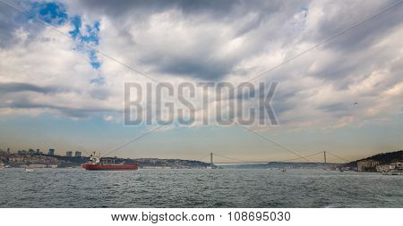 Bosphorus with buildings, bridge and cargo ship, Istanbul