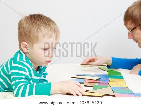 child playing with puzzle, early education