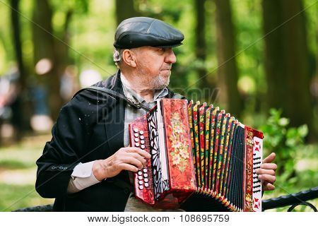 Street Busker performing songs in city park in Gomel, Belarus