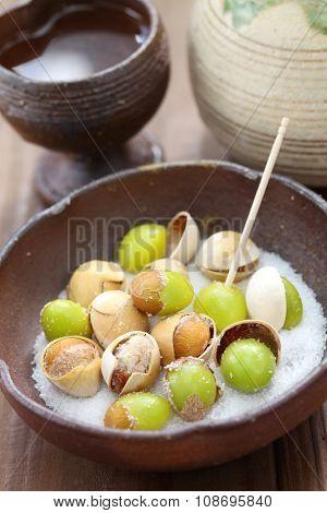 salt roasted ginkgo nuts and sake, japanese food