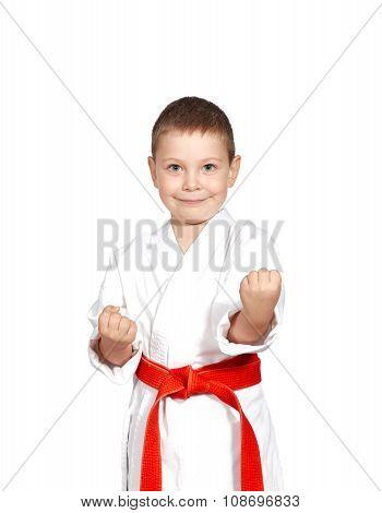 Little boy in a kimono on a white background