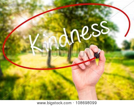 Man Hand writing Kindness with black marker on visual screen