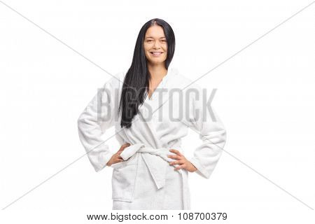 Cheerful woman in a white bathrobe looking at the camera and smiling isolated on white background