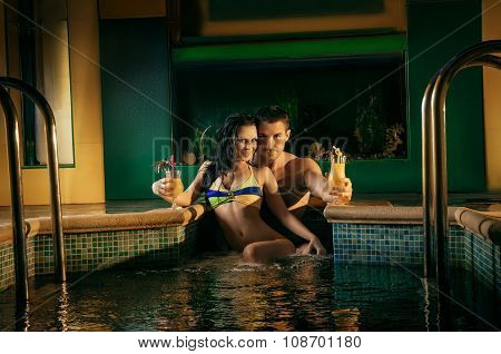 Romantic young couple in pool water lost in love