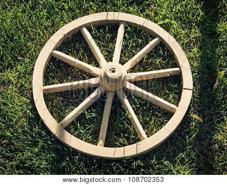 Old Wooden Wheel On The Grass