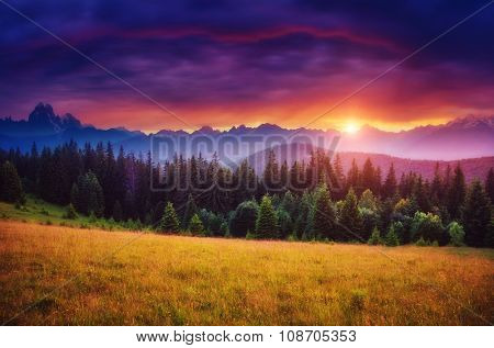 Fantastic mountain glowing by sunlight. Dark overcast sky in the morning. Dramatic and picturesque scene. Location Svaneti, Georgia, Europe. Beauty world. Creative collage. Soft filtered effect.