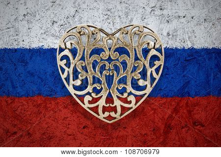 Bronze heart on Russia flag in background