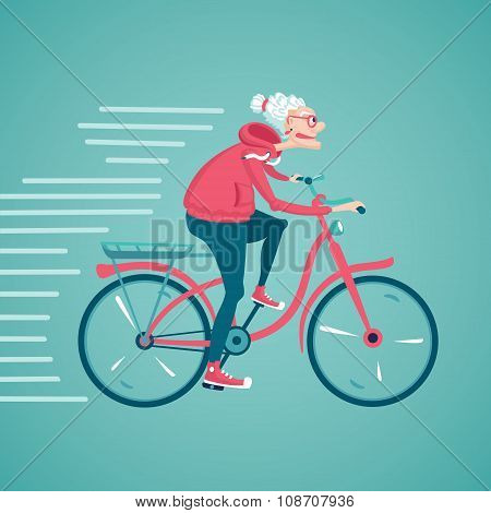 The old woman is riding a bicycle