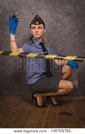 Policewoman Criminalist On A Crime Scene