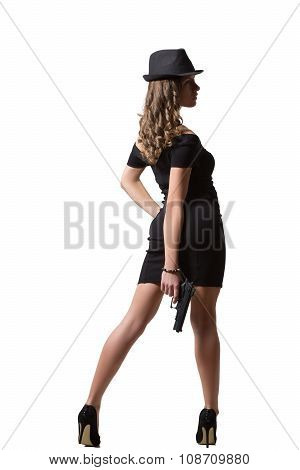 beautiful girl in evening dress and hat holding gun. Isolated on white background