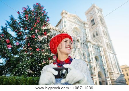 Traveler Woman Walking With Camera In Christmas Florence