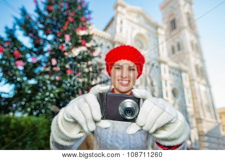 Woman Taking Photo In ?hristmas Decorated Florence. Close Up