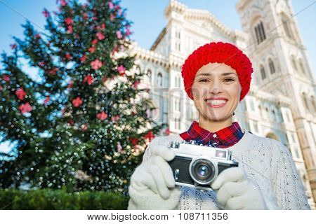 Woman With Camera Standing Near Duomo In Christmas Florence
