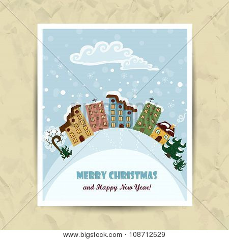 Christmas card with houses and the inscription